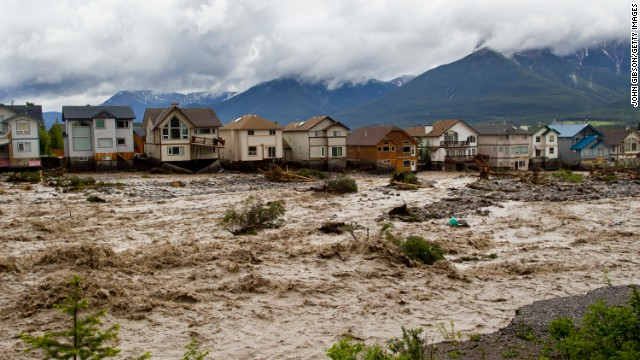 Flood-damaged homes along the edge of Cougar Creek are pictured on Thursday in Canmore, Alberta, Canada.
