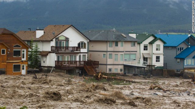 As many as 100,000 residents of Calgary, Alberta, could face evacuation because of flooding, the director of emergency management said early Friday.