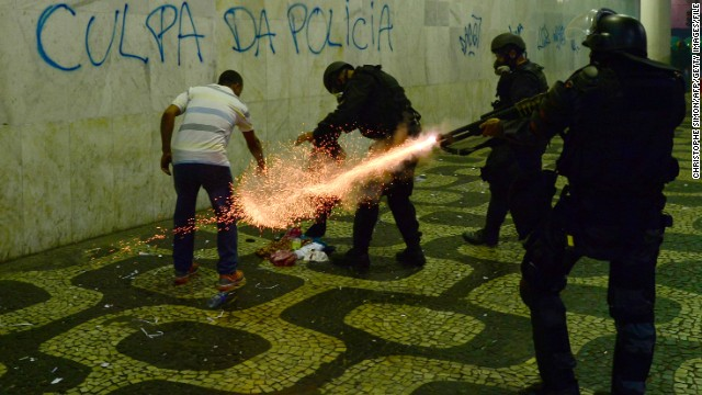 Anti riot police officers fire tear gaz in a corridor after clashes erupted during a protest against corruption and price hikes, on June 20, 2013.