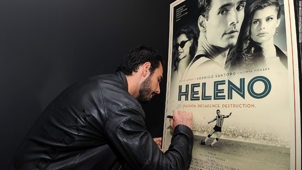 "Actor Rodrigo Santoro signs a poster for the film ""Heleno"", in which he plays the mercurial striker. A destructive personality, together with illness and drug problems prevented Heleno from becoming one of Brazil's greatest ever players. But he helped pave the way for some of the world's greatest soccer icons..."