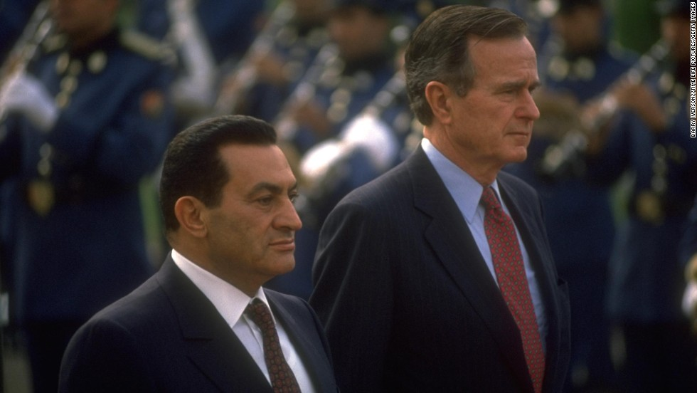 Former Egyptian President Hosni Mubarak and President George H.W. Bush stand together at a ceremony in Cairo, Egypt, on November 24, 1990.