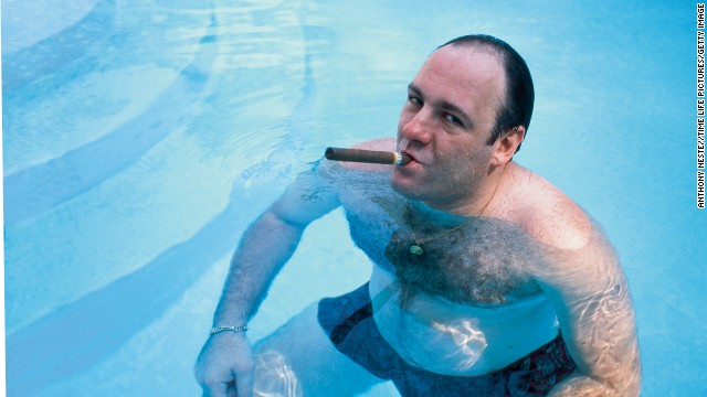 James Gandolfini, as Tony Soprano, smokes a cigar while he stands in pool, in a 1999 publicity still for the HBO's series 'The Sopranos.""