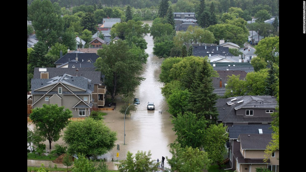 A wide view shows the flooded streets in Calgary's Sunnyside neighborhood on June 21.