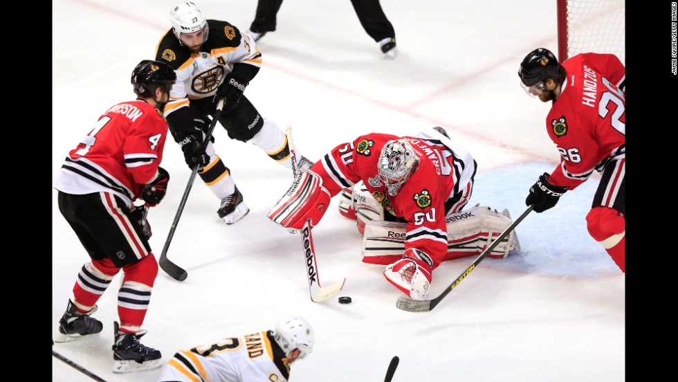 Corey Crawford of the Blackhawks makes a save against the Bruins.