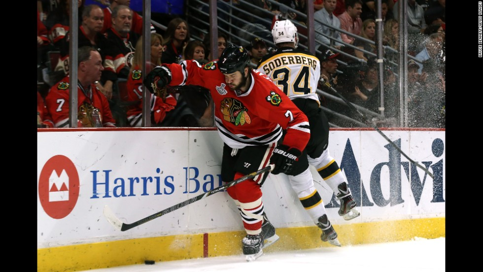 Boston's Carl Soderberg checks Chicago's Brent Seabrook.