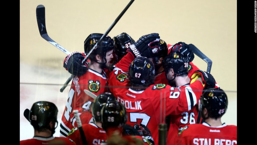 Members of the Chicago Blackhawks celebrate after defeating the Boston Bruins in Game Five of the 2013 NHL Stanley Cup Final at United Center on June 22, 2013 in Chicago, Illinois. The Blackhawks beat the Bruins 3-1, taking a 3-2 lead in the series.