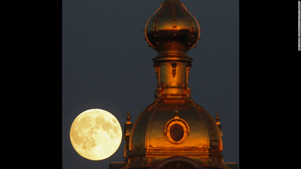 The moon rises behind the Peter and Paul Fortress in St. Petersburg, Russia, on June 22.
