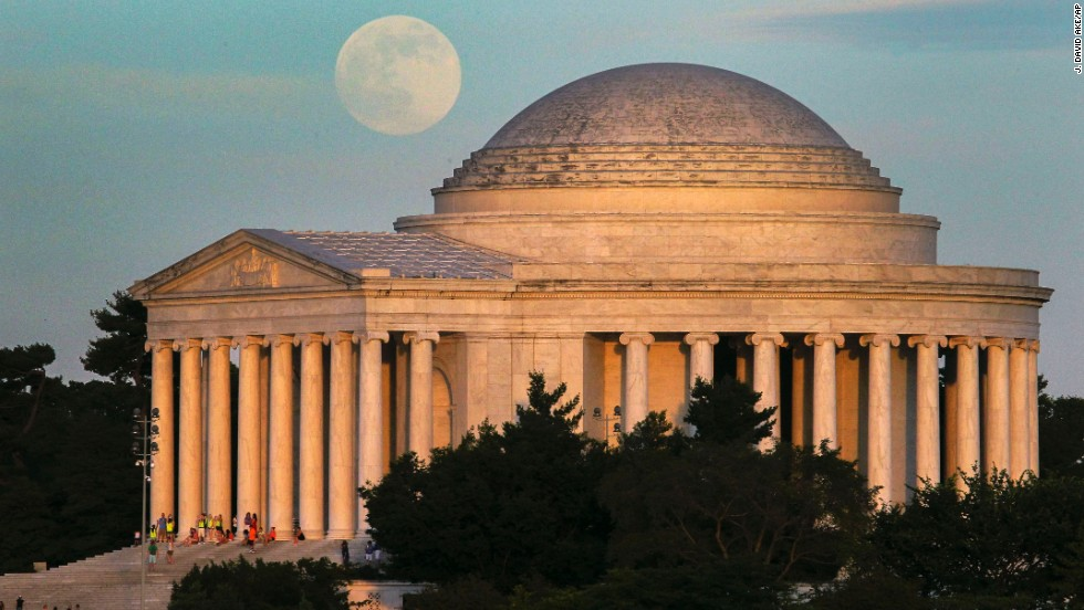 A full moon rises behind the Jefferson Memorial in Washington on June 22.