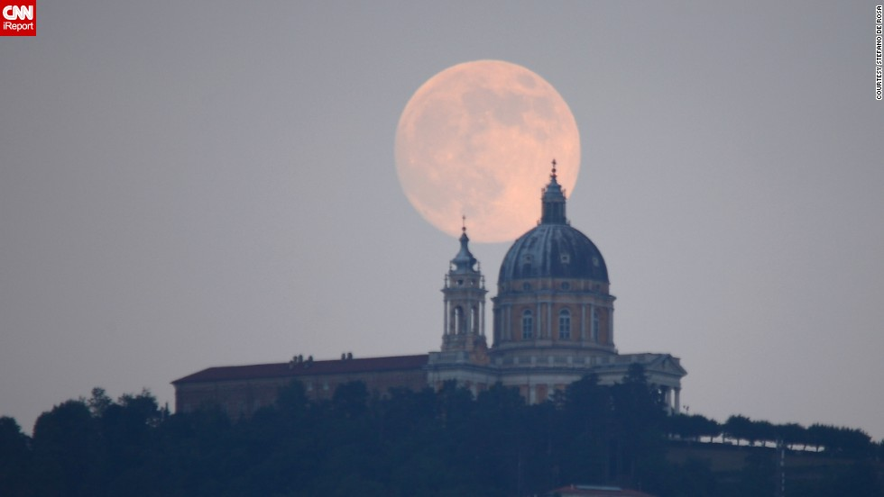 "<a href=""http://ireport.cnn.com/docs/DOC-993815"">Stefano De Rosa </a>sat on top of a hill in Turin, Italy, in order to feel closer to the supermoon that was shining over the city. ""I had to plan the shot a few days in advance and I was lucky to have a clear sky at the moment of the click,"" he said."
