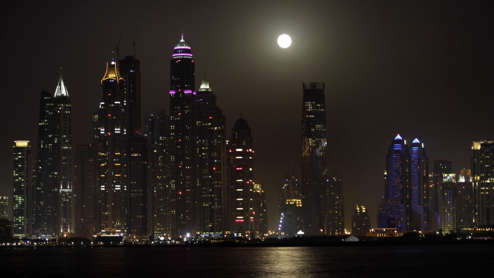 The supermoon is seen behind the Marina district towers in Dubai, United Arab Emirates, on June 23.