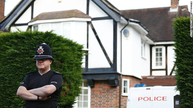 A policeman stands outside the home of Saad and Ikbal al-Hilli in Claygate, in Surrey, south-east England, on September 14, 2012.