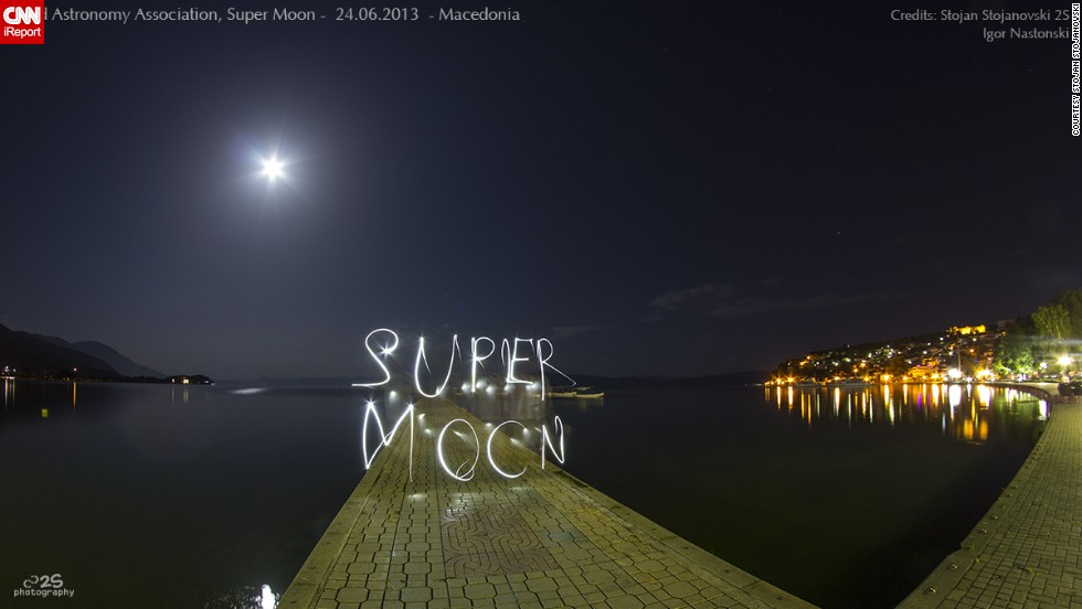 "Astronomy lover and photographer <a href=""http://ireport.cnn.com/docs/DOC-994166"">Stojan Stojanovski</a> wanted to remember the brightest supermoon of 2013 in a creative way. He photographed it in Ohrid, Macedonia, while tracing the word ""supermoon"" with a flashlight that he captured at a slow shutter speed."