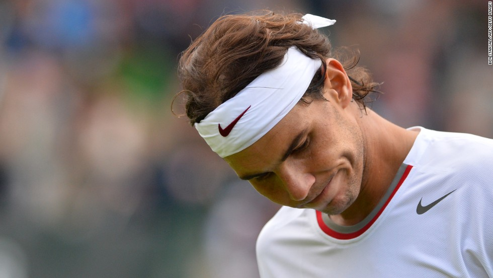 Nadal has also suffered hard times at Wimbledon. Here he reacts after a point in a defeat against Belgium's Steve Darcis in the first round of Wimbledon 2013. It was his earliest grand slam exit to date.