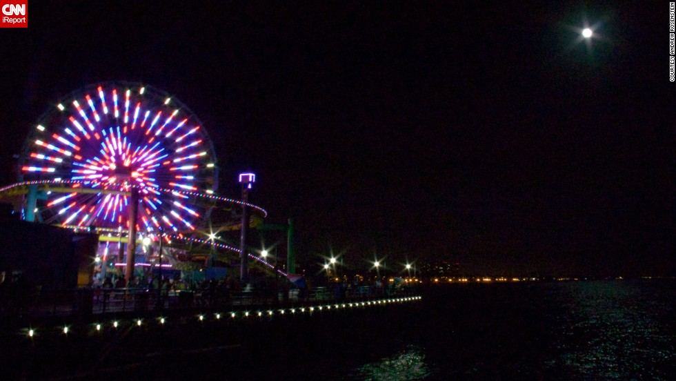 "<a href=""http://ireport.cnn.com/docs/DOC-994249 "">Andrew Rosenstein </a>was standing on the Santa Monica pier in California when he photographed the supermoon shining brightly next to a neon-colored ferris wheel. ""I find it to be an important endeavor of science to understand the universe around us,"" he said."