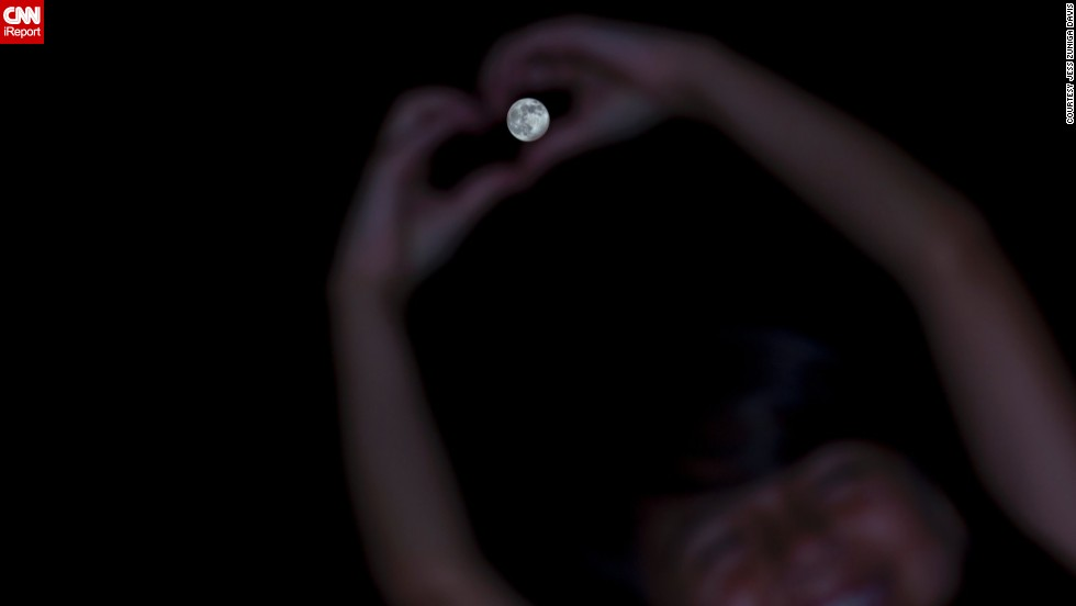 "In Galax, Virginia, photographer <a href=""http://ireport.cnn.com/docs/DOC-994291"">Jess Zuniga Davis</a> said her 8-year-old daughter Eva ""wanted to wrap her heart around the moon."""