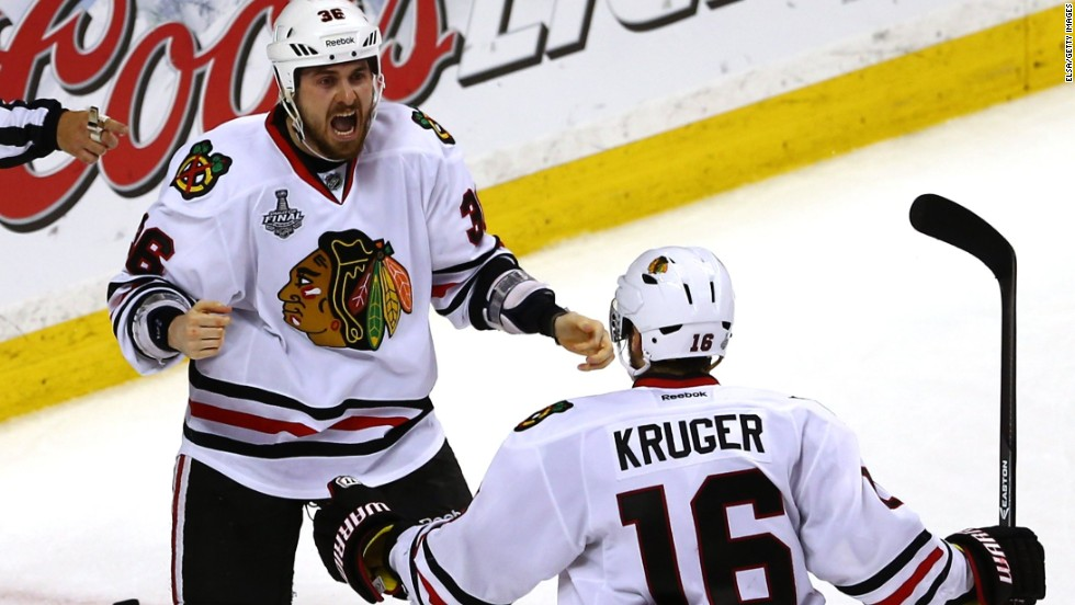 Dave Bolland of the Chicago Blackhawks celebrates with Marcus Kruger after scoring the game-winning goal late in the third period.