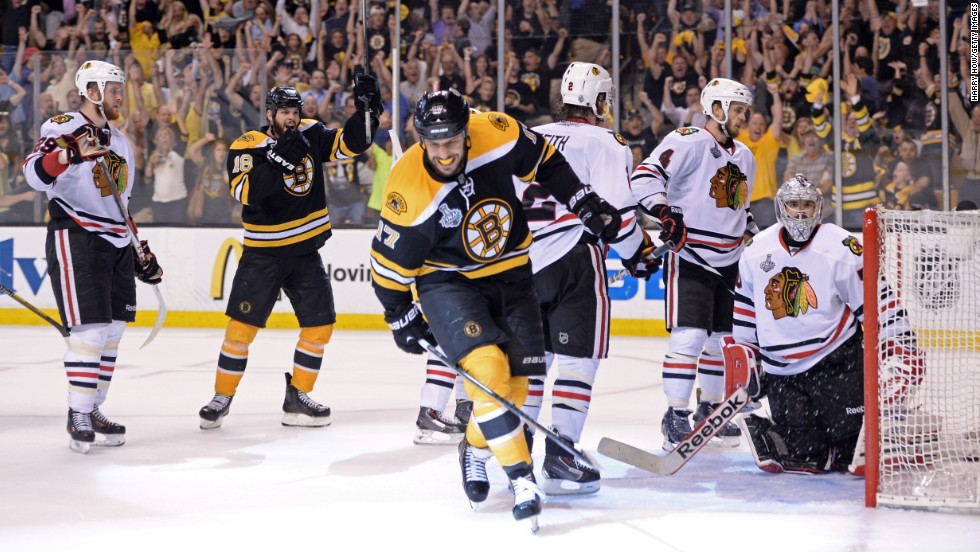 Lucic, center, celebrates his goal in the third period that gave the Bruins a 2-1 lead.