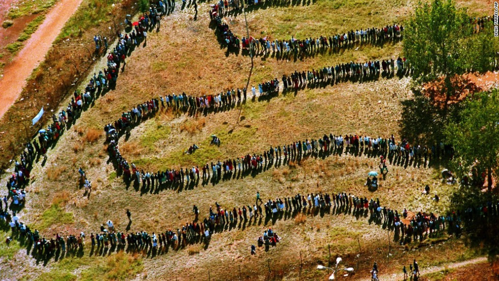 On April 27, 1994, a long line of people snake toward a polling station in the black township of Soweto outside of Johannesburg in the nation's first all-race elections.