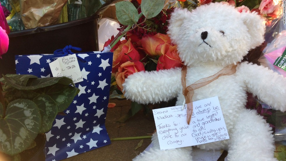 "A note, seen on June 26, tied around the neck of a teddy bear reads: ""Thanks for everything you've done for our country."""