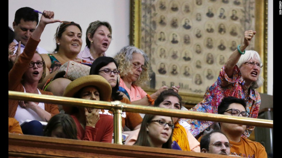 Members of the gallery react as Davis is called for her third and final violation, ending the filibuster. The reaction in the gallery grew so intense that it drowned out the proceedings, preventing lawmakers from completing their vote by the official end of the session -- killing the bill.