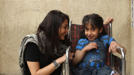 CNN reporter Moni Basu with Noor al-Zahra Haider in Baghdad, March 2013