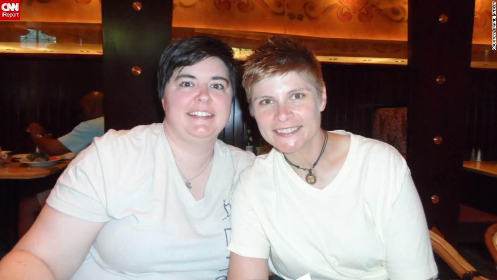 "Same-sex couples in the 37 states that do not allow gay marriage found themselves struggling with conflicting feelings after two key Supreme Court decisions. ""This ruling <a href=""http://ireport.cnn.com/docs/DOC-995576"">changes nothing on a personal level</a>,"" said Brandi Ansley, right, who lives with her partner in Georgia, which does not allow same-sex marriage. Still, ""it's definitely a step forward."""