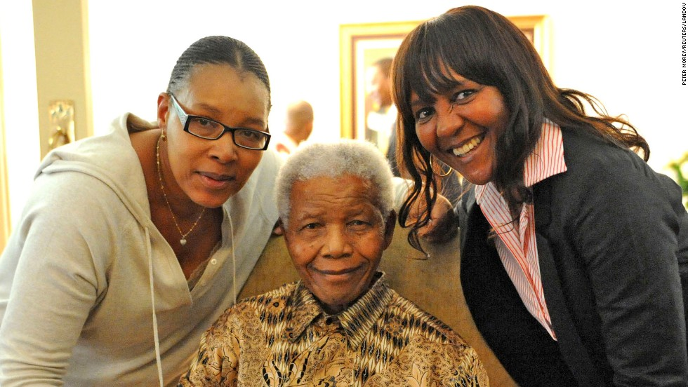 Mandela casts his ballot for the 2011 elections in South Africa with his daugher Princess Zenani Dlamini, left, and granddaughter Ndileka Mandela.