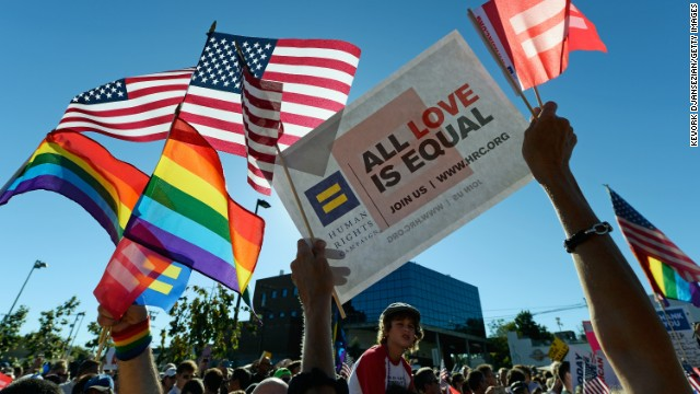 Same-sex marriage supporters celebrate the US Supreme Court ruling during a community rally on June 26, 2013 in West Hollywood, California.
