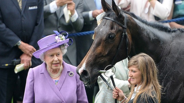 Queen Elizabeth II congratulates her horse Estimate following its Gold Cup win at Royal Ascot in 2013.