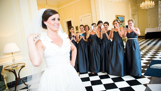 """I try to have fun with the camera phones everywhere,"" wedding photographer Angela Garbot said."
