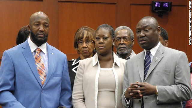 From left, Trayvon Martin's parents, Tracy Martin and Sybrina Fulton, and Benjamin Crump, the family's legal counsel, make a brief statement to the media before jurors heard opening statements on June 24.