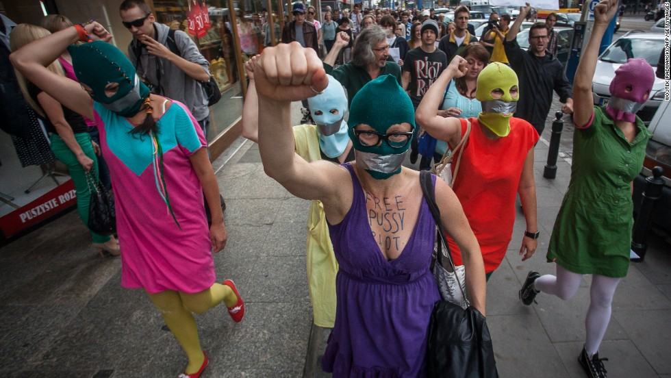 "<a href=""http://www.cnn.com/2012/08/17/world/pussy-riot-social-media/index.html"">Supporters of the Russian punk band Pussy Riot</a> wear masks and tape their mouths during a protest in front of the Russian embassy in Warsaw on August 17, 2012. The colorful ski masks were popularized by the feminist rockers."