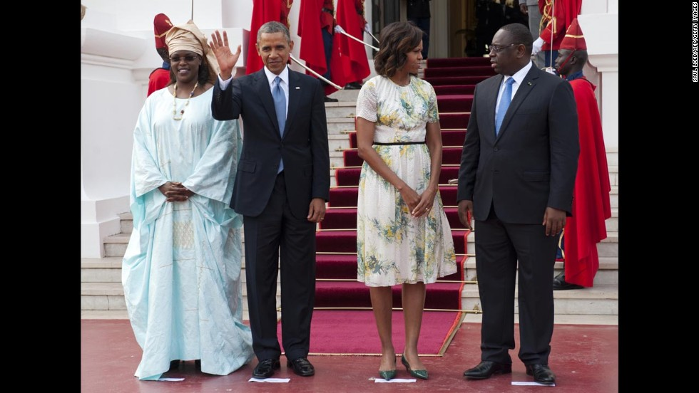 Senegal's President Macky Sall, right, and Sall's wife, Marieme Faye Sall, left, welcome the president and first lady as they arrive at the presidential palace prior to meetings in Dakar on June 27.