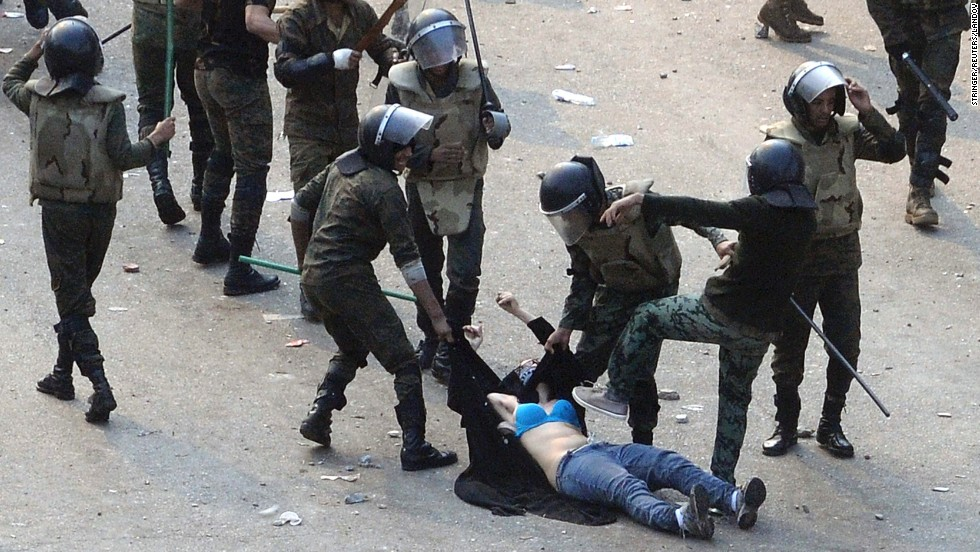 "Egyptian army soldiers beat a young woman during a protest at Tahrir Square in Cairo on December 17, 2011. The shocking image of the ""blue bra girl"" <a href=""http://www.cnn.com/2011/12/22/opinion/coleman-women-egypt-protest/index.html"">became a symbol of the oppression </a>and a rallying cry for several thousand Egyptian women."