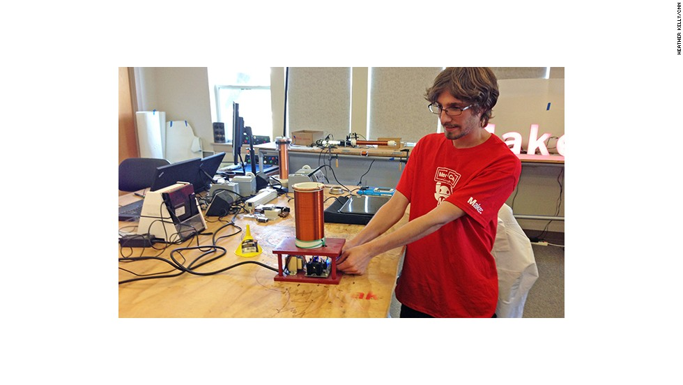 Brian Melani, an engineering intern at Maker Media, demonstrates a mini-Tesla coil, or electrical circuit. The test project could end up as a project in a future issue of Make magazine.