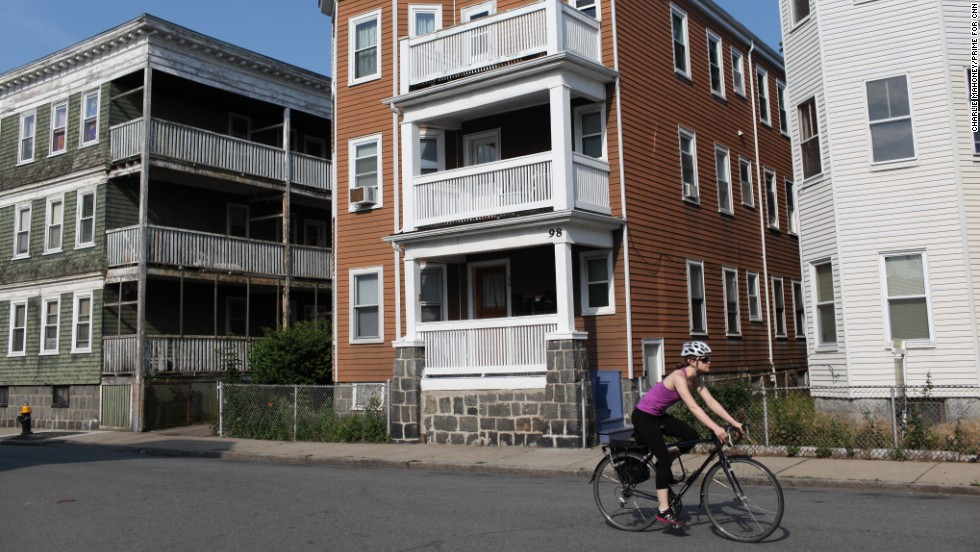 A lone cyclist rides by the apartment building where Renata lives in Boston.