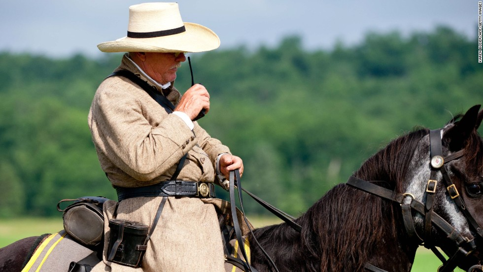In a rare concession to non-period technology, a Confederate officer speaks into his walkie-talkie to position his troops during a reenactment.
