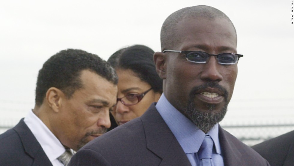 "<a href=""http://www.cnn.com/2013/04/05/showbiz/wesley-snipes-released"" target=""_blank"">Wesley Snipes</a> was helped by Smith, seen here in the background, during his tax fraud problems in 2006."