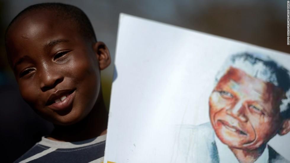 Mandela 'steadily improving' as he turns 95 in hospital