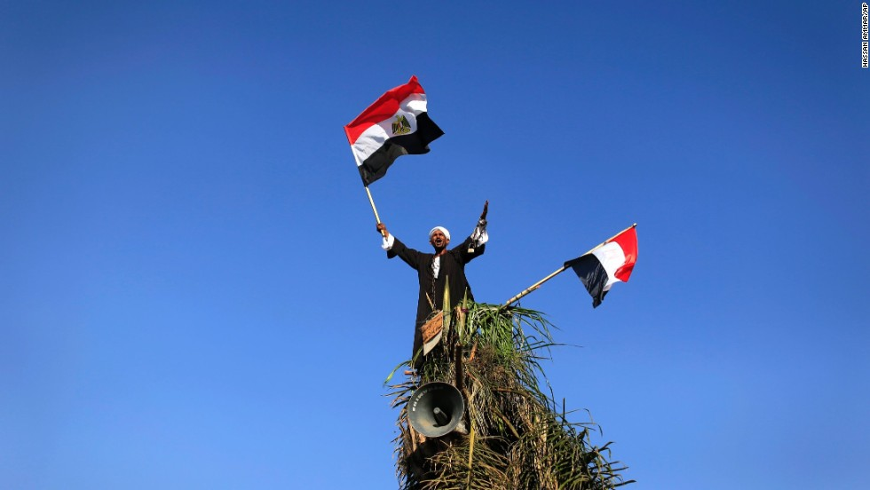 A Morsy opponent waves Egyptian flags during a protest outside the Egyptian Defense Ministry in Cairo on June 28.
