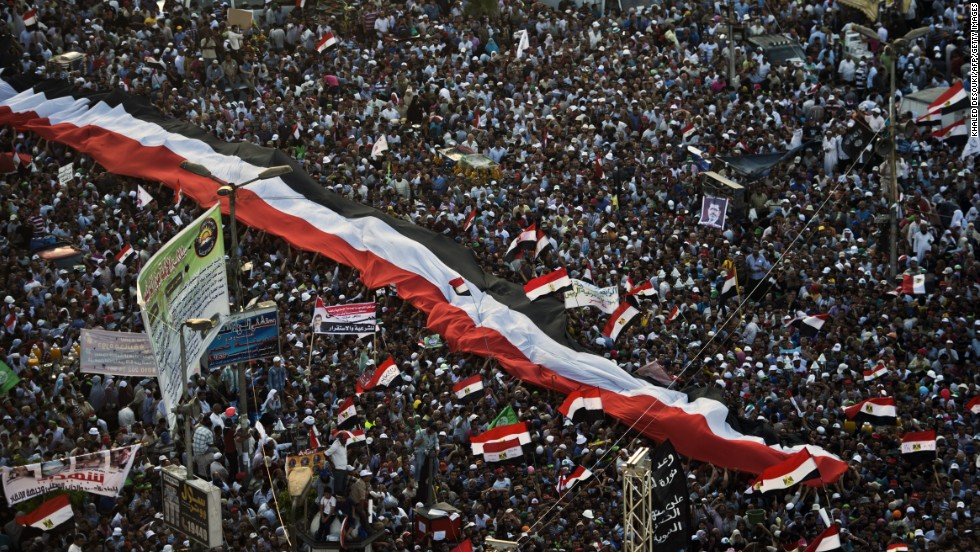 Morsy supporters demonstrate in Cairo on June 28.  Protests also erupted in Suez, Sharqia, El Monofia and Gharbiya, the state-run Ahram news agency said. And in the port city of Alexandria, so many people turned out that traffic virtually came to a standstill.
