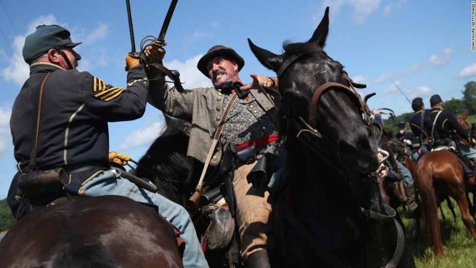 Union and Confederate actors skirmish during a re-enactment of the Battle of Gettysburg on Saturday, June 29.