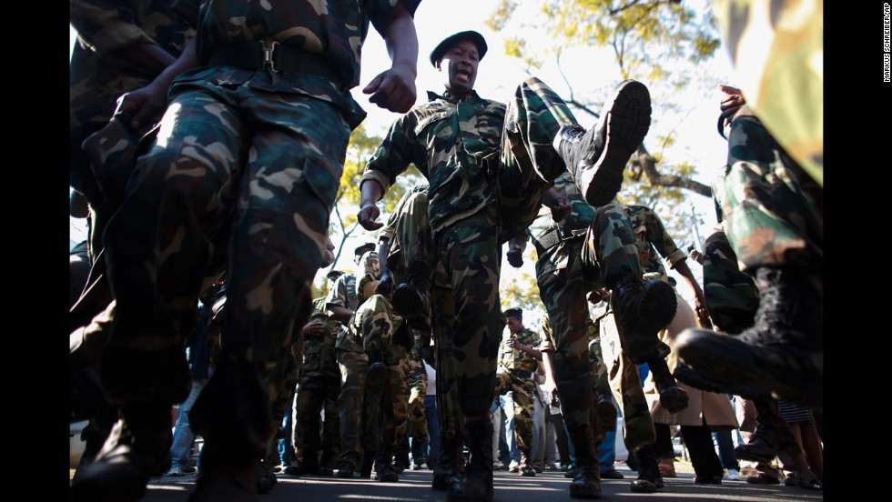 South African military veterans dance in support outside the hospital on June 30.