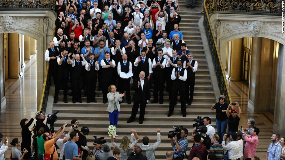 A chorus sings for newlyweds at City Hall in San Francisco on June 28.