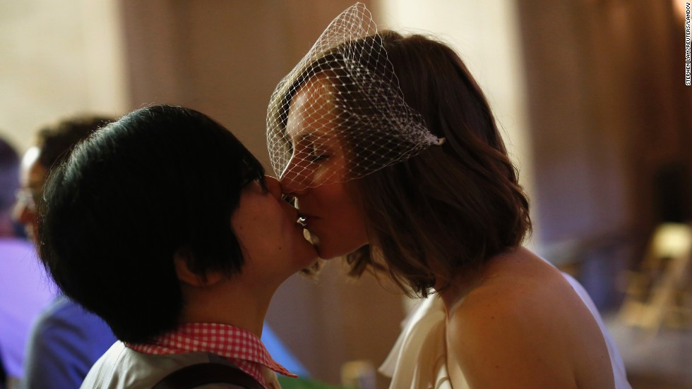 Ky Choi, left, and Ashlee Meyer kiss before getting married on June 29.