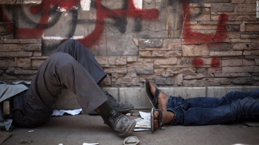 Protesters take a rest near Tahrir Square on June 30.