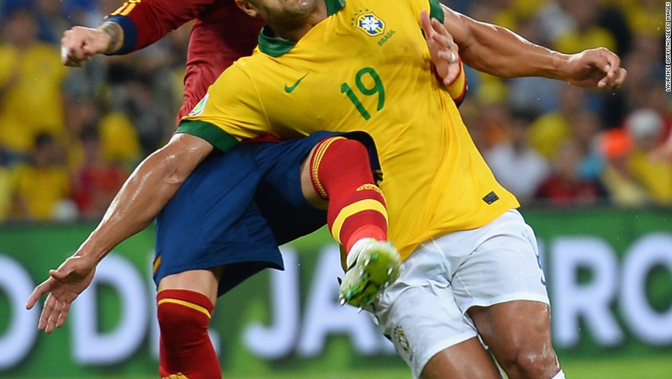 Hulk of Brazil and Sergio Ramos of Spain compete for the ball in a match the hosts dominated.