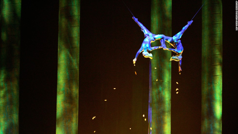 "In a November 2008 performance, Sarah Guillot-Guyard , left, and Sami Tiaumassi play ""Forest People"" during Cirque du Soleil's ""Ka"" at MGM Grand Resort in Las Vegas. Guillot-Guyard, 31, who was part of the original show cast, fell during the show finale on Saturday, June 29, and was pronounced dead shortly after."