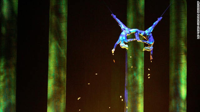"In this Nov. 28, 2008, photo, Sarah Guyard-Guillot, left, and Sami Tiaumassi perform as ""Forest People"" during Cirque du Soleil's ""Ka"" at MGM Grand Resort in Las Vegas. Guyard-Guillot, a mother of two young children, was pronounced dead at a hospital late Saturday night, June 29, 2013, after falling about 50 feet from the show's stage during a performance of Cirque du Soleil's ""Ka."" (AP Photo/Las Vegas Sun, Leila Navidi)"