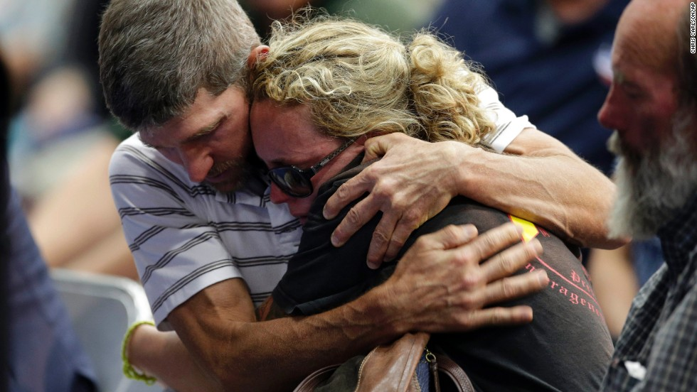 "A couple embraces during the Prescott memorial service for the fallen fighters on July 1. <a href=""http://www.cnn.com/2013/07/02/us/gallery/hot-shot-victims/index.html"">The elite team members' deaths</a> on Sunday, June 30, marked the deadliest day for firefighters since the 9/11 attacks."